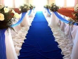 bridal decorations they aisle but darker blue front three rows reserved for family