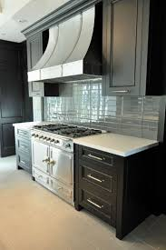 84 best cream ivory glass tile images on pinterest glass tiles gorgeous kitchen design with ebony kitchen cabinets la cornue range french curve range hood and blue glass tiles backsplash