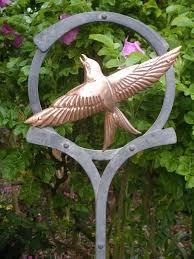 sculpture bird ring copper metal flying bird outdoor garden