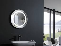 small oval illuminated lighted bathroom mirror with black wall