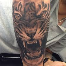 forearm black and grey tiger chronic ink