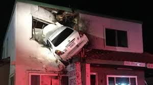 drugged up driver crashes car into second story of building