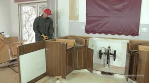How To Cover Kitchen Cabinets by How To Remove Kitchen Cabinets Youtube