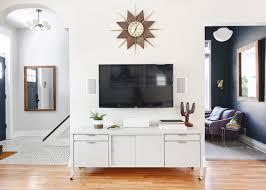 simple media console in open floor plan via yellow brick home