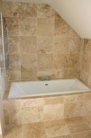 bathroom travertine bathroom tile and floor with bath up for