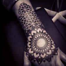 hand tatoo image black mandala hand tattoo