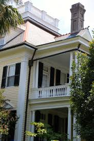 White House With Black Trim Shutters The Potted Boxwood