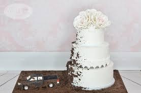 edible white dirt vintage buttercream wedding cake truck spraying dirt up wedding