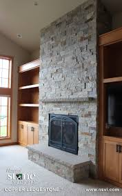 faboulus river rock application for corner stone fireplace