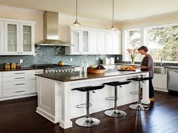 black and white appliance reno kitchen reno countertops wall light small floor cabinets bar