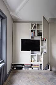 best 25 tv wall design ideas on pinterest tv walls tv units tv wall design idea hide shelves with large custom made cabinet doors storage spacesliving room
