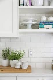 white subway tile kitchen backsplash our house kitchen reveal white flat front cabinets generic