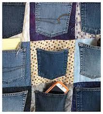 Hanging Organizer Make A Hanging Denim Pocket Organizer From Old Jeans