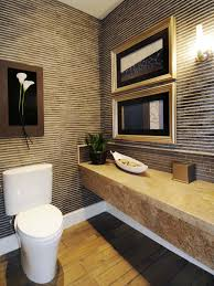 bathroom white toilet with powder room vanity and stone wall plus