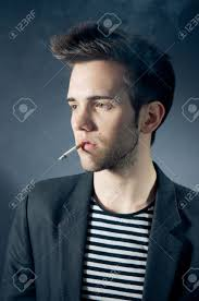 Cool Stock by Cool Young Man Smoking A Cigarette Stock Photo Picture And