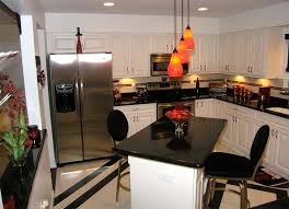 Kitchen With Red Appliances - remodelled kitchens in tampa