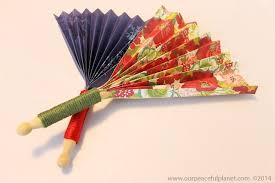 how to make a paper fan make quick pretty hand fans