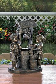 two children wishing well water garden yard decor