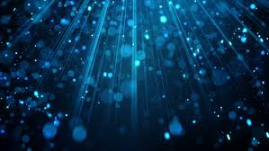 blue glitter particles falling in light rays abstract
