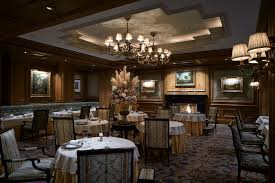 osaka fine dining restaurants the ritz carlton osaka formal dining room with upholstered and banquette seating wood paneled walls artworks and