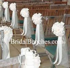 white tulle white satin wedding pew bows church
