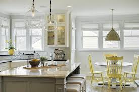 yellow dining chairs with gray pendant cottage kitchen