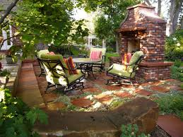 outdoor a garden in the back yard with a round table and sofa