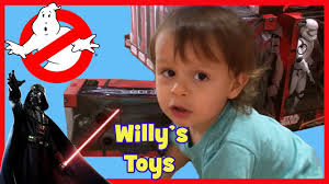 kid playing star wars disney toys and halloween costumes lego