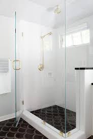 white shower surround with black cement fan shower floor tiles