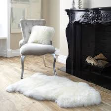 White Bedroom Mat Decor White Fur Rug With Cozy Bed And Wooden Floor For Bedroom