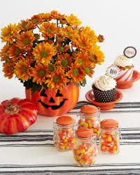 simple halloween table decor carved pumpkin vase glass candy jars