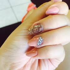 almond shaped nails w rockstar glitter and rhinestones