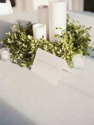 candle wedding centerpiece purple and greenery centerpiece simple
