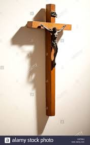 wooden crucifix simple wooden crucifix on wall stock photo royalty free image