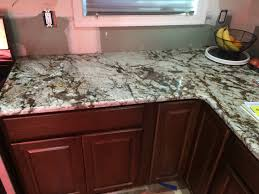 White Tiger Granite And Hampton Bay Cognac Cabinets Just Looking - Cognac kitchen cabinets