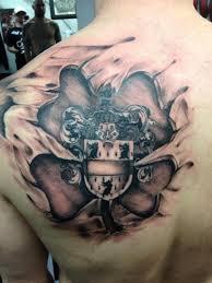 family crest skin rip on shoulder blade tattoos
