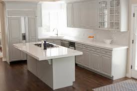 White Kitchen Cabinets With Black Granite Brown Laminated Wooden Floor Design Ideas Black Mozaic Tile