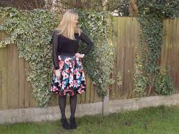 floral skirt with high heeled ankle boots what lizzy loves