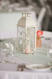white lantern and bud vase centerpieces