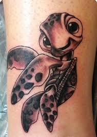 grey and black sea turtle on arm