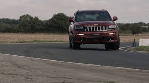 racing jeep grand cherokee jeep grand cherokee srt takes on a stunt plane u2013 video