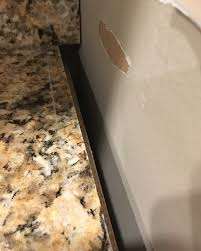 how do you fill the gap between kitchen cabinets and ceiling gap between granite and kitchen walls
