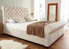 delightful upholstered sleigh bed with cream headboard and white