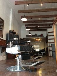 deep bowl pendants add industrial feel to classic barbershop