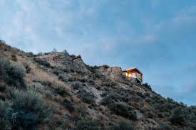 living on the edge a glass and concrete cantilevered studio in