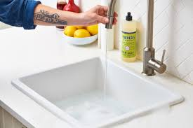 Slow Draining Bathroom Sink Baking Soda by How To Clean Your Kitchen Sink U0026 Disposal Apartment Therapy