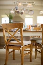 white dining chairs pads wooden legs pottery barn dining room