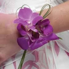 orchid wrist corsage add decorative steel or grasses for a clean simple look don