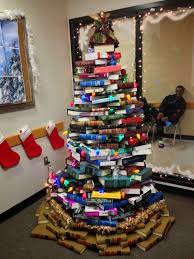 a christmas tree made out of law books in the dallas county public