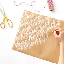 make your own wrapping paper diy christmas calligraphy wrapping paper cable car couture
